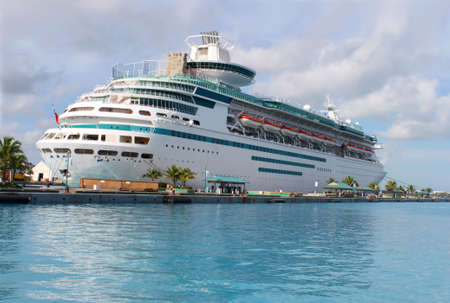 Cruise ship in the clear blue Caribbean ocean docked in the port of Nassau, Bahamas