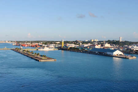 View of the port of Nassau with cruise ship docks in the forefront in the early evening sun Archivio Fotografico