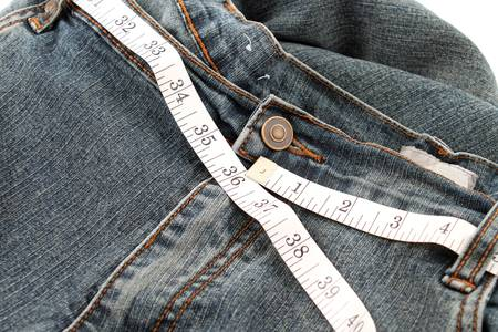 circumference: Measuring tape measuring 36 inches which is a healthy waist circumference for men.