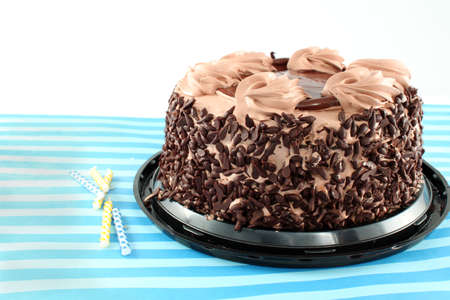 chocolaty: Black Forest Chocolate cake with candles on a striped background Stock Photo