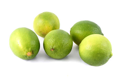 Green healthy citrus limes on a white background (not isolated)