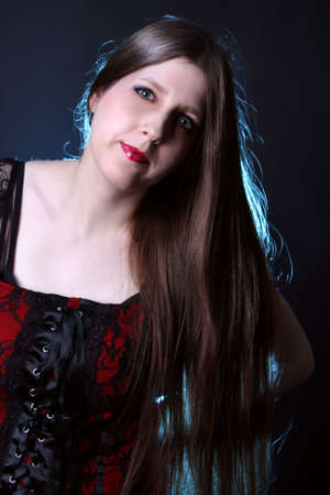 longhaired: Pretty woman with really long shiny brown hair and red lipstick  on a black background