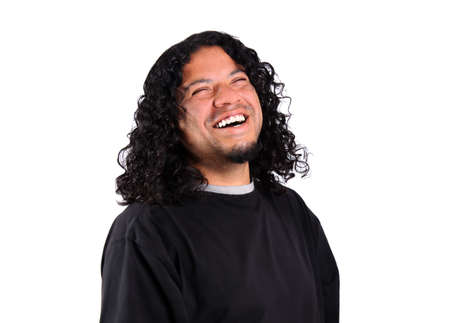 Multi-racial male with bright white teeth smile and long curly hair on a white background photo