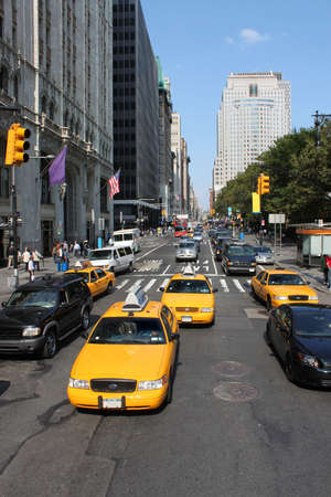 Typical New York City street with traffic and yellow taxis Stock Photo