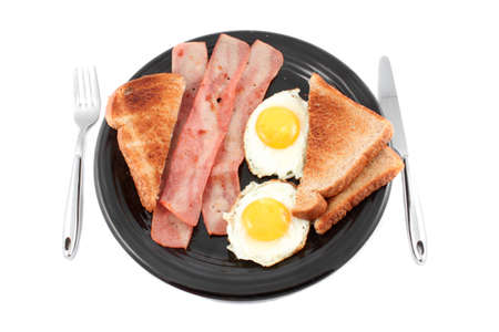 buttered: Bacon, buttered toast and fried eggs for breakfast, isolated on a white background