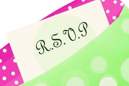 rsvp: RSVP  note in pink and green polkadot envelope