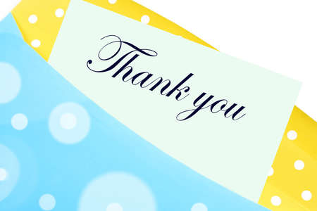 thanking: Thank you note or letter in yellow and blue polkadot envelope Stock Photo
