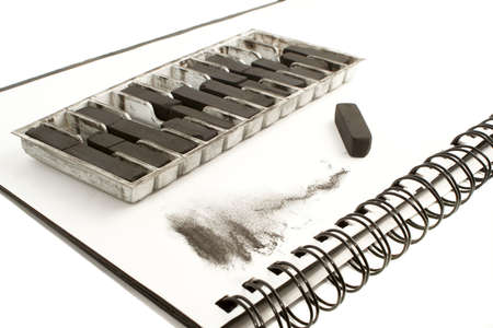 smudge: Artists black charcoal with smudge showing texture of medium on drawing book Stock Photo