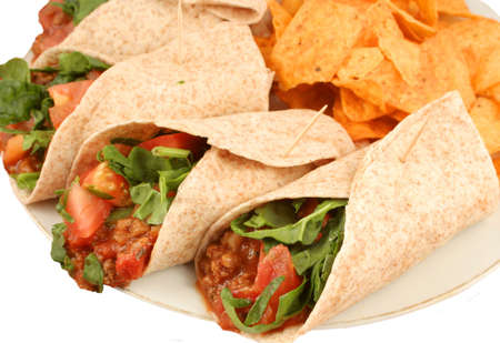 Delicious and colorful mexican fajitas or wraps, and crunchy nacho chips Stock Photo