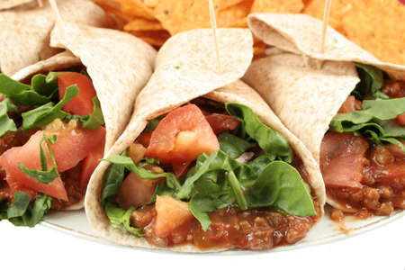 dinnertime: Delicious and colorful mexican fajitas or wraps, and crunchy nacho chips Stock Photo