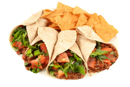 Delicious and colorful mexican fajitas or wraps, and crunchy nacho chips isolated on a white background photo