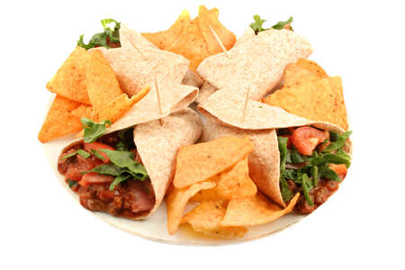 tortillas: Delicious and colorful mexican fajitas or wraps, and crunchy nacho chips isolated on a white background