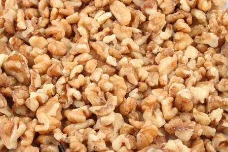 background and  closeup of protein filled healthy walnuts
