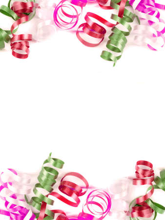 party favors: colorful festive curled up ribbon good for background or border in red and green on white Stock Photo