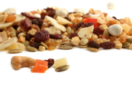 Delicious and healthy mixed dried fruit, nuts and seeds on a white background Stock Photo - 6291935