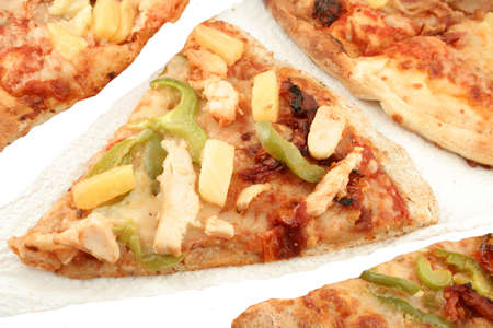 doughy: Multigrain crust pizza with different types of toppings like chicken, green peppers, and pineapple Stock Photo