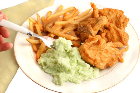 Southern fried chicken, french fries smothered with gravy and creamy coleslaw dinner on a white background