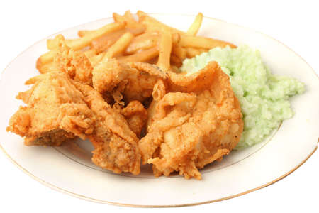 smothered: Southern fried chicken, french fries smothered with gravy and creamy coleslaw dinner on a white background