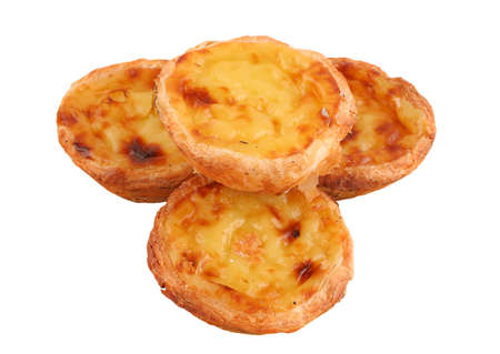 nata: Traditional Portuguese flaky custard pastries called pastel de nata isolated on a white background Stock Photo