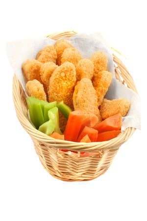 A basket of crispy chicken fingers with vegetables on a white background photo