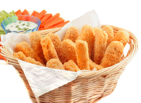 A basket of crispy chicken fingers with platter of vegetables and dip isolated on a white background Foto de archivo