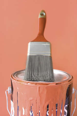 Paintbrush on top of contemporary rust colored  paint can for diy home decorating Stock Photo