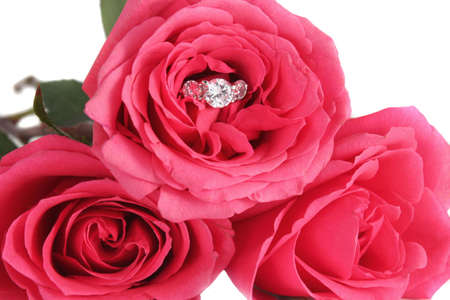 diamond ring: Sparkling diamond engagement ring in  pink rose on a white background great for valentines Stock Photo