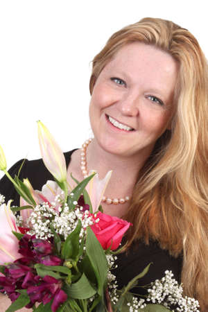 Pretty blond woman with freckles in her thirties wearing a pearl necklace holding a flower bouquet Stock Photo - 6719513