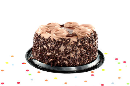 chocolaty: Fancy chocolate cake surrounded by confetti ready for a party isolated on a white background
