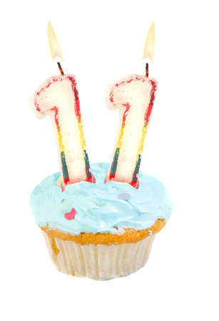 eleven: Eleventh birthday cupcake with blue frosting on a white background Stock Photo