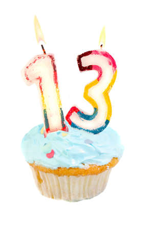 thirteen: Thirteenth birthday cupcake with blue frosting on a white background