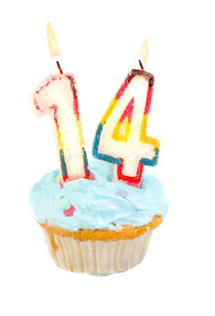 Fourteenth birthday cupcake with blue frosting on a white background photo