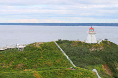 enrage: Lighthouse on cliff of Cape Enrage in New Brunswick, Canada