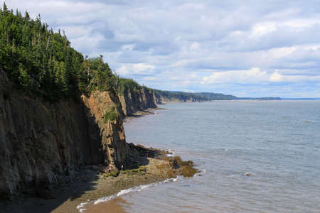 enrage: Dramatic cliifs of Cape Enrage along the Bay of Fundy, in New Brunswick, Canada