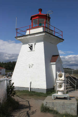 oceanic: Lighthouse at Cape Enrage in New Brunswick, Canada showing foghorn in the front or image Stock Photo