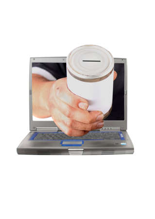 begging: Dirty mans hand holds a tin can with blank label through laptop computer screen asking for online donation