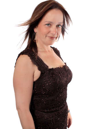 Pretty close up portrait of woman in her forties with confidence dress in sparkly dress