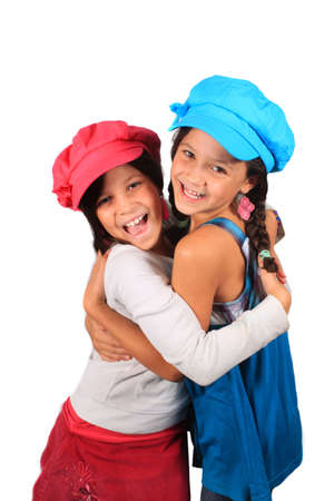 be dressed in: Pretty young girls in the ages of eight and ten who could be sisters or best friends dressed in colorful clothing and hats