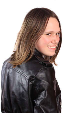 Teen girl filled with with a smile wearing a leather jacket  Imagens