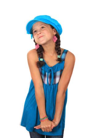 wishful: Pretty ten year old adolescent multi ethnic girl with pigtails and colorful blue hat looking bashful or wishful on a white background