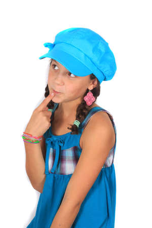 Pretty ten year old adolescent girl with braids and colorful blue dress and hat, thinking or contemplating Imagens