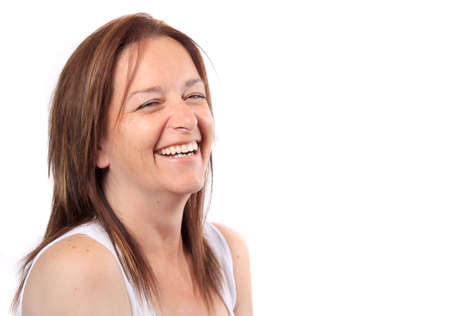 Pretty close up portrait of woman in her forties with great skin and smiling Stock Photo