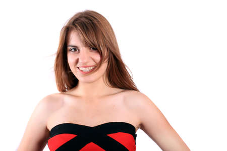 Pretty portrait of a   teenage girl wearing a red and black dress smiling with white background photo