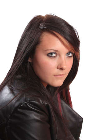 Pretty brunette teenage girl with red streaks in her hair and leather jacket on a white background