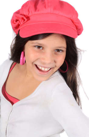 windswept: Pretty eight year old adolescent multi ethnic girl with windswept long dark hair on a white background wearing colorful pink hat Stock Photo