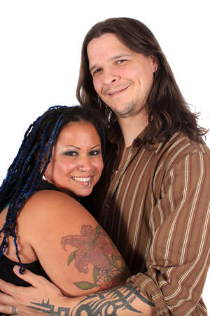 Happy diverse multi race couple smiling and holding eachother on a white background photo