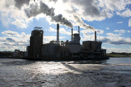 Pulp and paper mill beside the Reversing Falls in Saint John,  New Brunswick, Canada