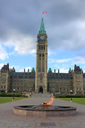 ottawa: Parliament building in the capital of Canada, Ottawa with eternal burning flame in foreground