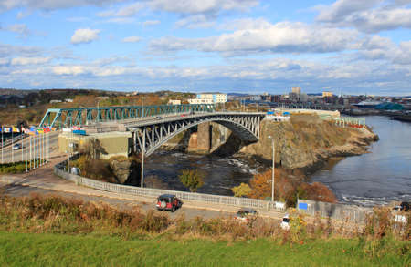 reversing: View of downtown Saint John, New Brunswick, Canada with the Reversing Falls and bridge in the foreground Stock Photo