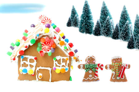 Gingerbread man and woman cookies standing beside house  with different colored candy and gumdrops, a chrismas snow scene  Archivio Fotografico